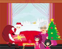 Grandmother with granddaughters waiting for Santa Claus Royalty Free Stock Image