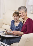 Grandmother and Granddaugter looking through album Stock Images