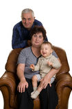 Grandmother, grandfather and grandson sitting in a Stock Photo