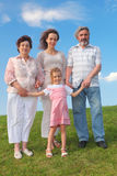Grandmother, grandfather, mother and little girl Stock Photo