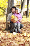 Grandmother and grandkid in the autumn park Stock Photography