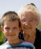 Grandmother And Grandson. Portrait of a grandmother and her grandson, taken outdoors Stock Images