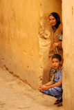 Grandmother and grandson. Standing at the entrance to their home in medina, Fez, Morocco Stock Image