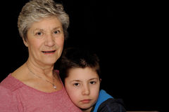Grandmother and Grandson. Stand side by side.  Right side left for copy Stock Images