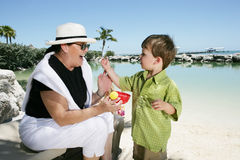 Grandmother and Grandson. A grandmother talks with her grandson on a tropical beach Royalty Free Stock Image