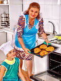 Grandmother and grandson baking cookies Stock Photos