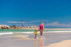 Grandmother with grandson on the beach. Grandmother with grandson having fun on the beach Stock Photo