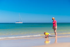 Grandmother with grandson on the beach. Grandmother with grandson having fun on the beach Stock Image