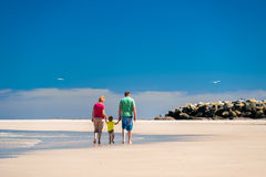 Grandmother with grandson on the beach. Grandmother with grandson having fun on the beach Stock Photos