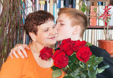 Grandmother and grandson with a bouquet  Stock Image