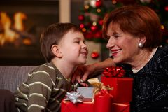 Grandmother and grandson at christmas stock image