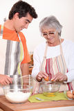 Grandmother and grandson cooking Royalty Free Stock Photography