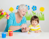 Grandmother with grandson drawing Royalty Free Stock Image
