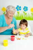 Grandmother with grandson drawing Royalty Free Stock Photos