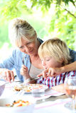 Grandmother with grandson eating Royalty Free Stock Images