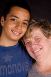 Grandmother and grandson happily smiling Stock Images