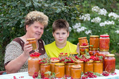 Grandmother and grandson with  homemade preserves Royalty Free Stock Images