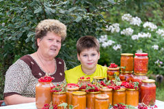 Grandmother and grandson with  homemade preserves Stock Photo