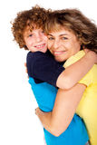 Grandmother and grandson hugging each other Stock Photography