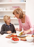 Grandmother And Grandson Making Sandwich Stock Photos