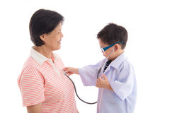 Grandmother and grandson playing as doctor and patient Royalty Free Stock Photography