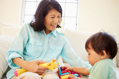 Grandmother And Grandson Playing With Toy Together Royalty Free Stock Images