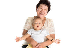 Grandmother and grandson. Portrait of Asian grandmother and grandson. Isolated on white background Royalty Free Stock Photography