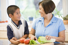 Grandmother And Grandson Preparing meal Stock Photography
