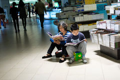 Grandmother and grandson reading in the bookstore Royalty Free Stock Photography