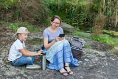 Grandmother and grandson relaxing in park Royalty Free Stock Photography