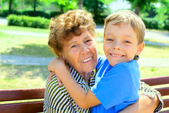 Grandmother with grandson. Series. Happiness grandmother and grandson in the park. Series Stock Photography