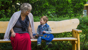 Grandmother and grandson singing together Stock Images