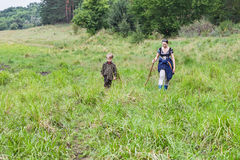 Grandmother with grandson striding meadow Royalty Free Stock Photos