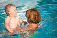 Grandmother and grandson swim Stock Images