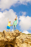 Grandmother and grandson on top of the rock Royalty Free Stock Images