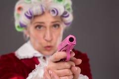 Grandmother with gun Stock Photos