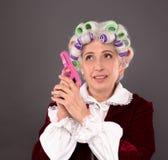 Grandmother with gun Stock Photo