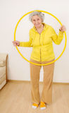 Grandmother gymnastic exercises Royalty Free Stock Images