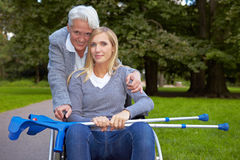 Grandmother with handicapped. Happy grandmother with handicapped grandchild in a park stock image
