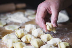 Grandmother hands at cooking vareniki with cottage cheese Royalty Free Stock Photography