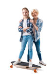 Grandmother and happy granddaughter with skateboard Stock Photos