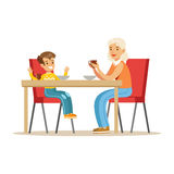 Grandmother Having Breakfast With Boy, Part Of Grandparents Having Fun With Grandchildren Series Royalty Free Stock Image