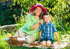 Grandmother having a picnic with grandchild. In the garden Stock Photo
