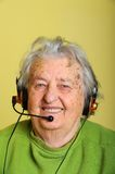Grandmother with headphones Royalty Free Stock Photo