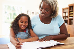 Grandmother Helping Granddaughter With Homework Stock Photography