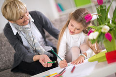 Grandmother helping granddaughter with homework Royalty Free Stock Image