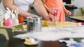 Grandmother helping granddaughter make cookies stock video footage