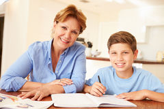 Grandmother Helping Grandson With Homework Stock Image