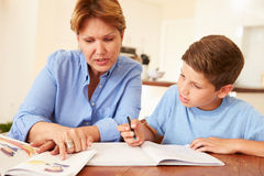 Grandmother Helping Grandson With Homework Stock Images