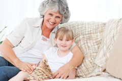 Grandmother helping her little girl Stock Photo